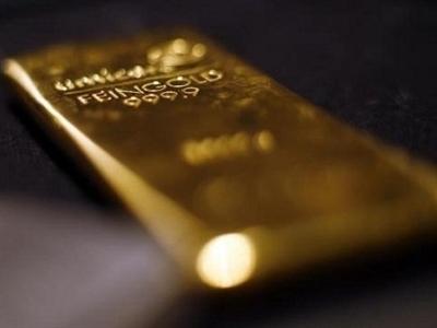Giá vàng giảm xuống dưới 1.200 USD/ounce khi USD, chứng khoán mạnh lên