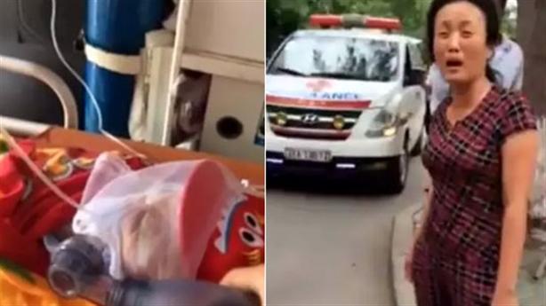 Con cán bộ y tế đập phá xe chở người chết