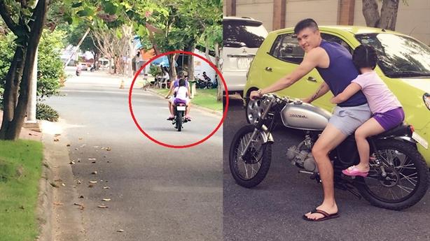 Công Vinh đi xe độ chở con gái không mũ bảo hiểm