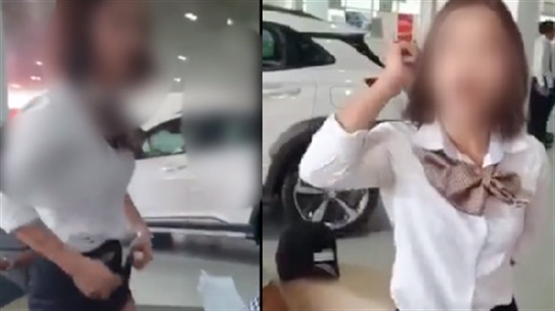Nữ nhân viên vén váy tranh cãi: Đại lý Hyundai lên tiếng