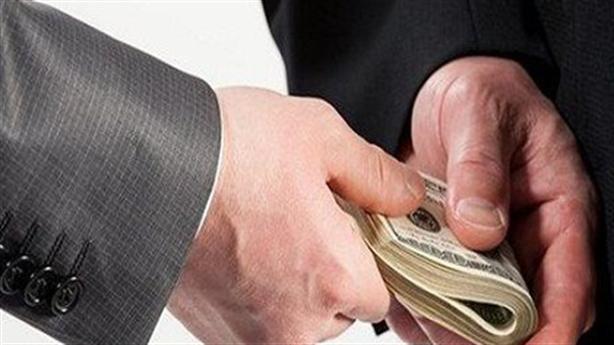 Bắt một đại uý nhận hối lộ tại quán cafe