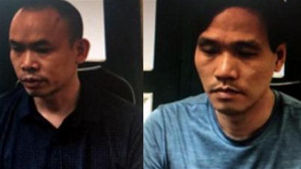 Hai kẻ đứng trên nóc chung cư bắn xuống đường Hà Nội