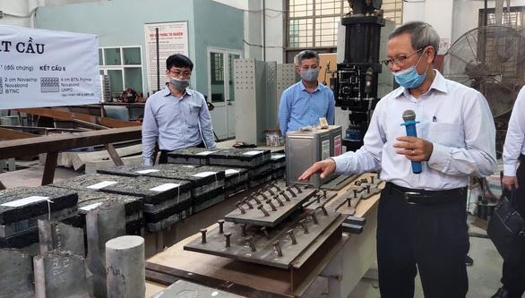 Sửa mặt cầu Thăng Long bằng công nghệ mới: Vẫn băn khoăn